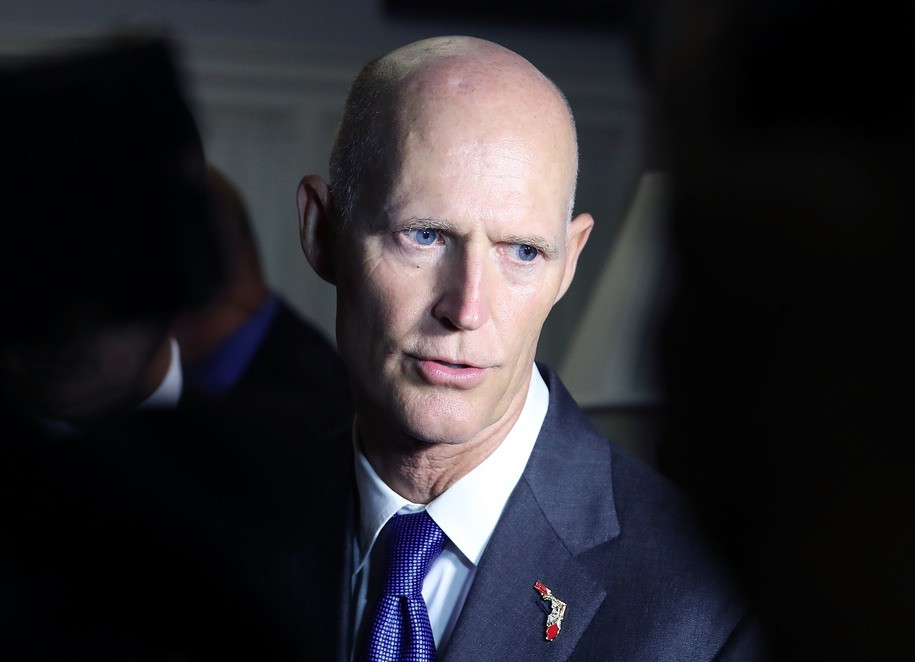 Florida Gov. Rick Scott sues to nullify votes, impound voting equipment as recount continues