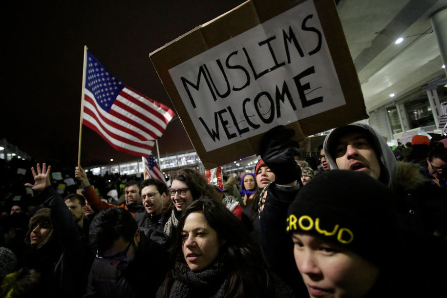 "Demonstrators protest agaist President Trump's executive immigration ban at Chicago O'Hare International Airport on January 28, 2017..US President Donald Trump signed the controversial executive order that halted refugees and residents from predominantly Muslim countries from entering the United States. Trump boasted Saturday that his ""very strict"" crackdown on Muslim immigration was working ""very nicely,"" amid mounting resistance to the order which has been branded by many as blatantly discriminatory. / AFP / Joshua LOTT        (Photo credit should read JOSHUA LOTT/AFP/Getty Images)"