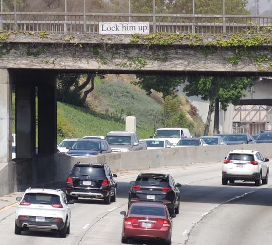 """Lock him up."" sign over the Pasadena Freeway."