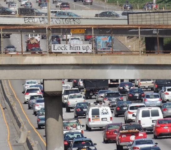 """Lock him up."" sign over Santa Monica Freeway."