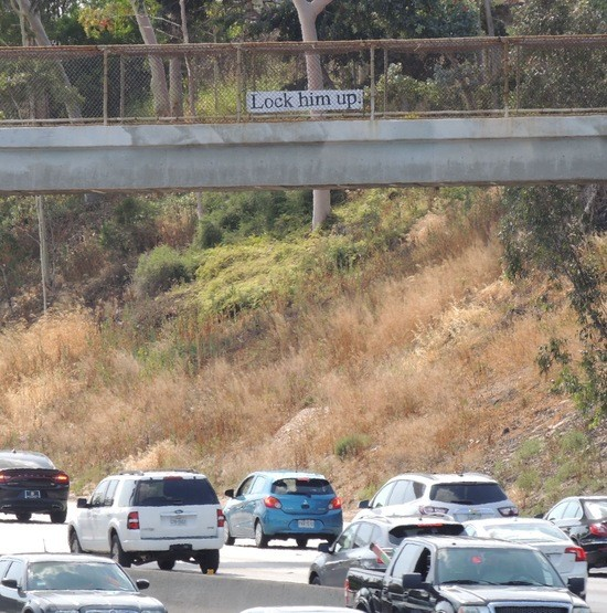 """""""Lock him up."""" sign over the Santa Monica Freeway westbound."""