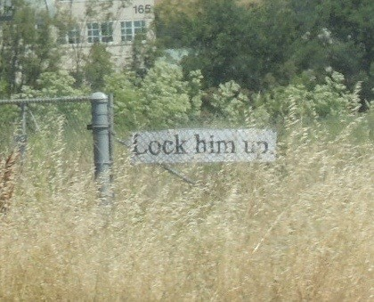 Lock him up sign next to US 101.
