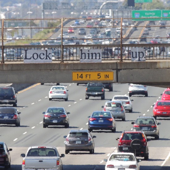Lock him up sign over I-80