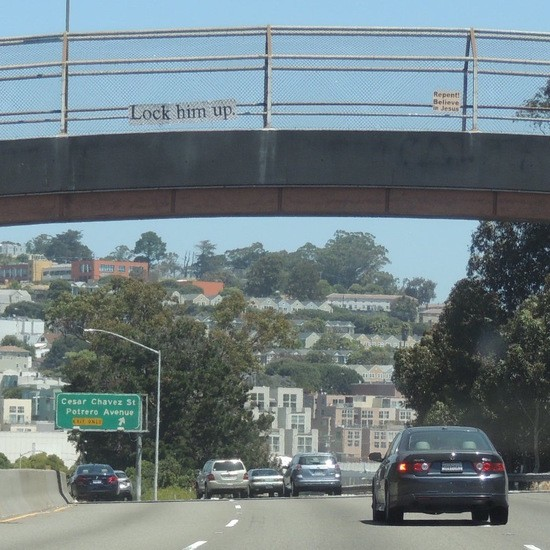 Lock him up sign over US 101.