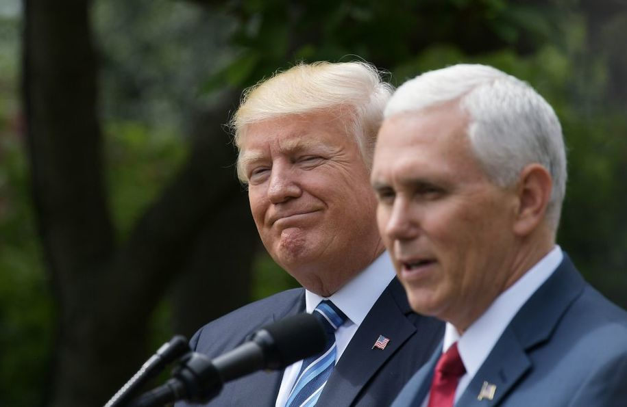 US Vice President Mike Pence (R) speaks while standing next to US President Donald Trump during a ceremony before the signing of an Executive Order on Promoting Free Speech and Religious Liberty in the Rose Garden of the White House on May 4, 2017 in Washingto.Trump issued an executive order on Thursday making it easier for churches and religious groups to take part in politics without risk of losing their tax-exempt status, a senior White House official said. / AFP PHOTO / Mandel NGAN        (Photo credit should read MANDEL NGAN/AFP/Getty Images)