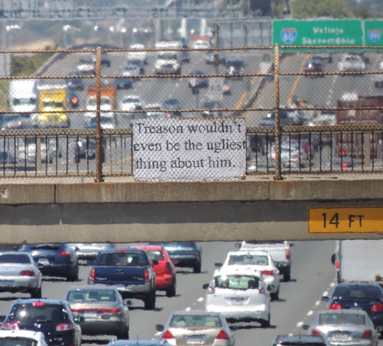 """""""Treason wouldn't even be the ugliest thing about him."""" sign over Interstate 80."""