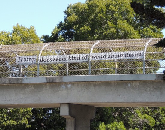 """""""Trump does seem kind of weird about Russia."""" sign over Highway 1."""