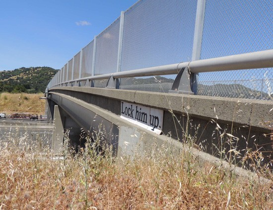 """""""Lock him up.""""  sign on Marin Co. overpass"""