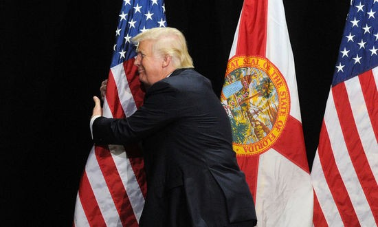trump-hugs-flag.jpg