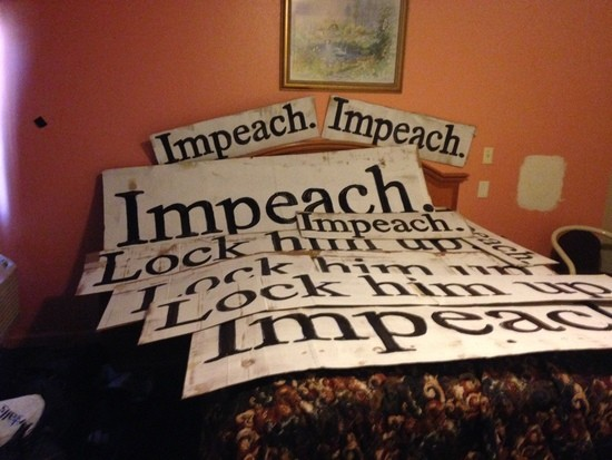Lock him up and Impeach signs in motel.
