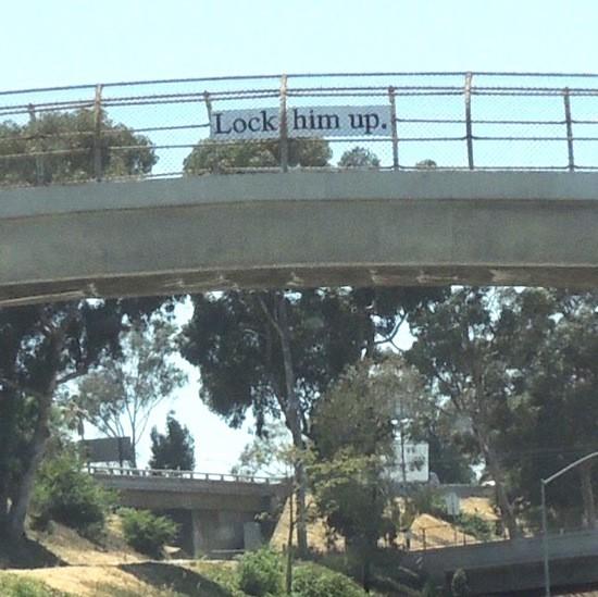 Lock him up sign over Pomona Freeway.