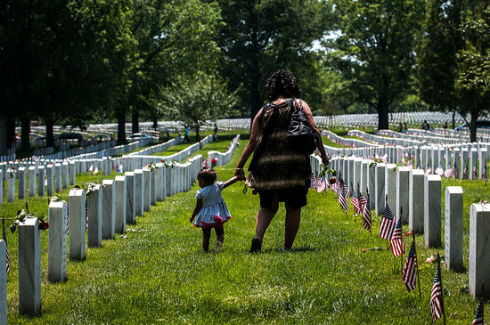 ARLINGTON, VA - MAY 25:   A mother and daughter stand in Section 60 on Memorial Day at Arlington National Cemetery on May 25, 2015 in Arlington, Va. U.S. President Barack Obama, Chairman of the Joint Chiefs of Staff U.S. Army General Martin Dempsey and U.S. Defense Secretary Ash Carter honored fallen soldiers during a ceremony at Arlington on this Memorial Day.  (Photo by Gabriella Demczuk/Getty Images)