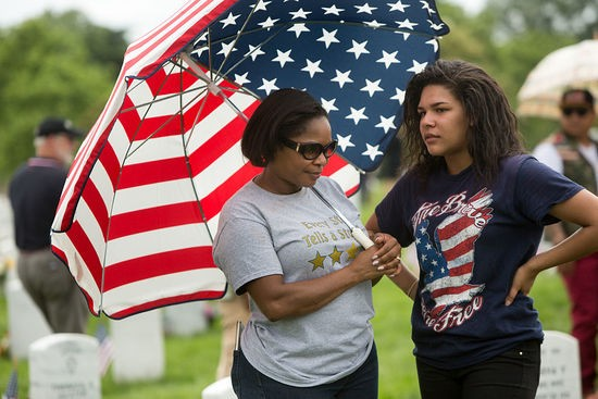 ARLINGTON, VA - MAY 30: Terri Dunn Campbell of Virginia Beach, Virginia, stands with her daughter Nicole Campbell, 18, at the grave of her oldest son Kielin Terrell Dunn, who was killed at age 19 in Afghanistan in 2010, in Section 60, the burial ground for military personnel killed since 2001, at Arlington National Cemetery on May 30, 2016 in Arlington, Virginia. (Photo by Allison Shelley/Getty Images)