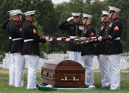 ARLINGTON, VA - AUGUST 31:  US Marines fold an American flag over the remains of US Marine PFC Anthony Brozyna, of Hartford, CT., during a full honor burial service at Arlington National Cemetary, August 31, 2016 in Washington, DC. Brozyna was 22 years old when he was killed in World War II on the island of Betio in the Tarawa Atoll of the Gilbert Islands during a battle on November 20, 1943.  (Photo by Mark Wilson/Getty Images)