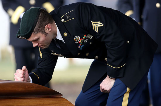 ARLINGTON, VA - DECEMBER 05:  Special forces members pay their respects at the  casket of fallen colleague U.S. Army Staff Sgt. Kevin J. McEnroe at the conclusion of the soldier's burial service at Arlington National Cemetery December 5, 2016 in Arlington, Virginia. McEnroe and two other members of the 1st Special Forces Command were killed during an attack outside a military base in Jordan on November 4, 2016.  (Photo by Win McNamee/Getty Images)