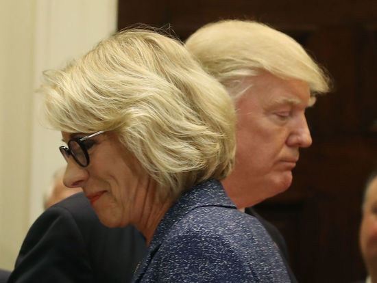 WASHINGTON, DC - APRIL 26: U.S. President Donald Trump stands with Education Secretary Betsy DeVosÊbefore signing the Education Federalism Executive Order that will pull the federal government out of K-12 education, in the Roosevelt Room at the White House, on April 26, 2017 in Washington, DC.. (Photo by Mark Wilson/Getty Images)