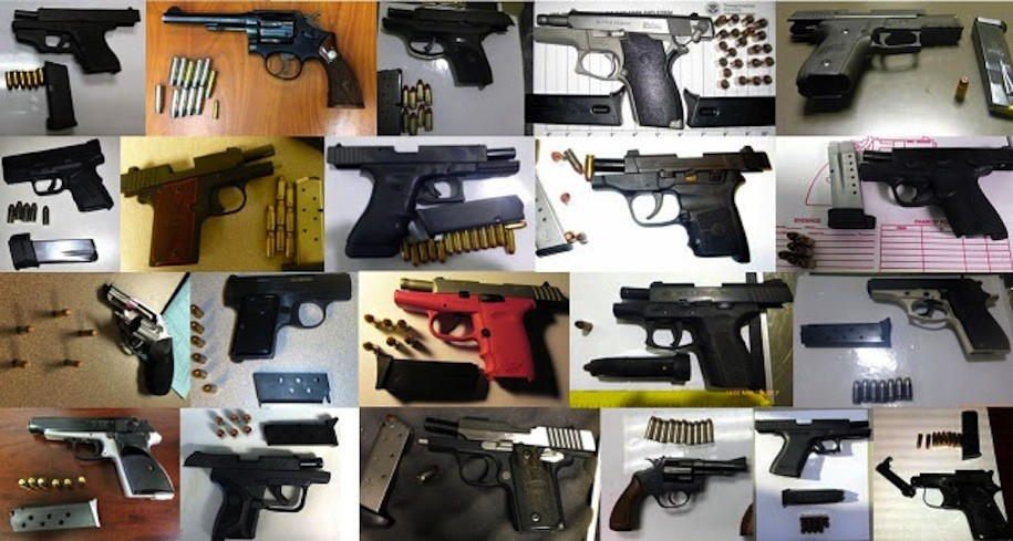 Twenty-one of 65 guns discovered by TSA agents in carry-on luggage at airports across the country, during the week of March 20-26, 2017.