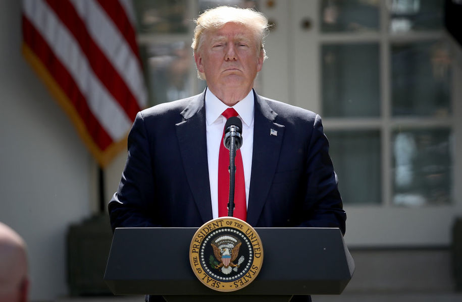 WASHINGTON, DC - JUNE 01:  U.S. President Donald Trump concludes his announcement to withdraw the United States from the Paris climate agreement in the Rose Garden at the White House June 1, 2017 in Washington, DC. Trump pledged on the campaign trail to withdraw from the accord, which former President Barack Obama and the leaders of 194 other countries signed in 2015. The agreement is intended to encourage the reduction of greenhouse gas emissions in an effort to limit global warming to a manageable level.  (Photo by Win McNamee/Getty Images)