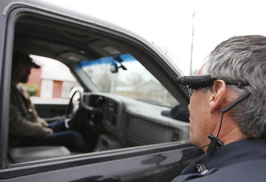 WEST VALLEY CITY, UT - MARCH 2: West Valley City patrol officer Gatrell performs a traffic stop on the first day of use of his newly-issued body camera attached to the side of a pair of glasses on March 2, 2015 in West Valley City, Utah. West Valley City Police Department has issued 190 Taser Axon Flex body cameras for all it's sworn officers to wear starting today. (Photo by George Frey/Getty Images)
