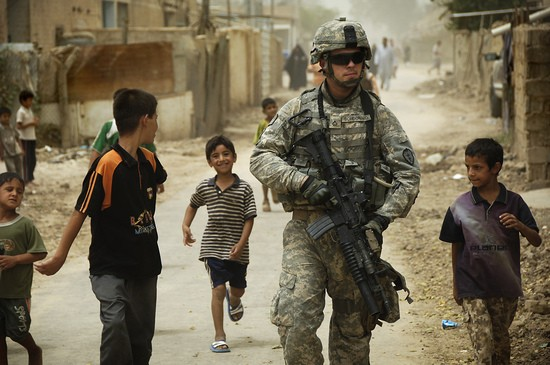080804-A-8725H-341 ..      Iraqi children gather around as U.S. Army Pfc. Shane Bordonado patrols the streets of Al Asiriyah, Iraq, on Aug. 4, 2008.  Bordonado is assigned to 2nd Squadron, 14th Cavalry Regiment, 25th Infantry Division.  DoD photo by Spc. Daniel Herrera, U.S. Army.  (Released)