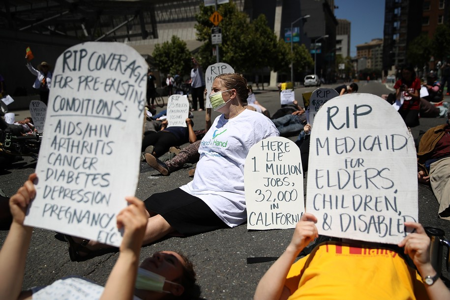 SAN FRANCISCO, CA - JUNE 21:  Healthcare activists hold headstones as they stage a die-in while protesting the Trumpcare bill on June 21, 2017 in San Francisco, California. Dozens of healthcare activists and senior citizens staged a protest outside the San Francisco Federal Building to express their opposition of the American Heathcare Act bill that is being drafted behind closed doors by Republican senators.  (Photo by Justin Sullivan/Getty Images)