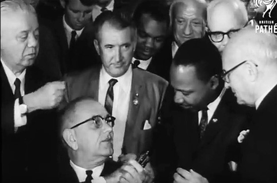 July 2 1964. President Lyndon Baines Johnson presents Rev. Dr. Martin Luther King Jr. with one of the pens used to sign the Civil Rights Act