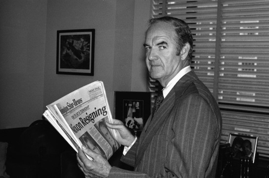 Sen. George McGovern, D-S.D., 1972 Democratic presidential candidate, reads a looks newspaper?s headline saying ?Nixon Resigning? on Thursday, August 8, 1974 in his Washington office. (AP Photo/HLG)