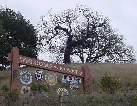 Impeach sign on Welcome to Novato sign