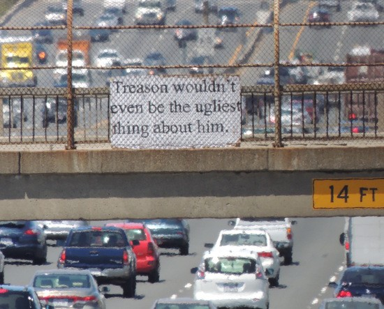 """""""Treason wouldn't even be the ugliest thing about him."""" sign over I-80"""