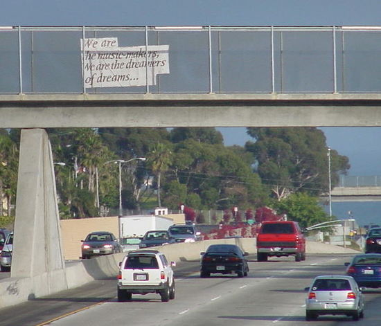 """""""We are the music makers, we are the dreamers of dreams..."""" sign over Interstate 5."""