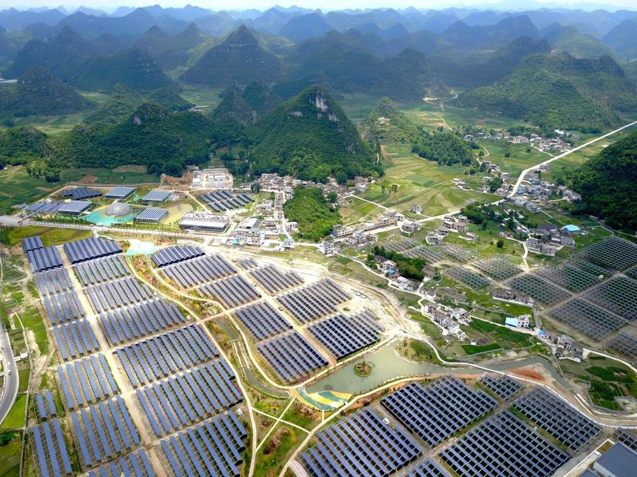 This photo taken on June 10, 2017 shows greenhouses built with solar panels on their roofs, in Yang Fang village in Anlong, in China's southwest Guizhou province. .The combination of greenhouses and solar power generation is part of a 294 million USD project which when completed will deliver 150 megawatts of electricity and provide jobs for 2000 people. / AFP PHOTO / STR / China OUT        (Photo credit should read STR/AFP/Getty Images)