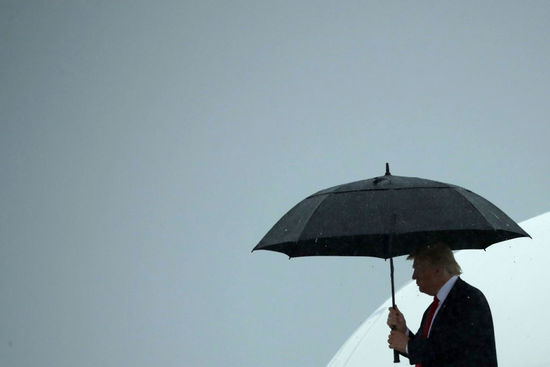 JOINT BASE ANDREWS, MD - JULY 28: U.S. President Donald Trump uses an umbrella after stepping out of Air Force One July 28, 2017 in Joint Base Andrews, Maryland. Trump announced via Twitter that he had fired Chief of Staff Reince Priebus and was replacing him with Homeland Security Secretary John Kelly. (Photo by Chip Somodevilla/Getty Images)