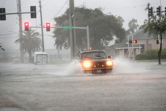 GALVESTON, TX - AUGUST 26: A vehicle navigates a street flooded by rain from Hurricane Harvey on August 26, 2017 in Galveston, Texas. Harvey, which made landfall north of Corpus Christi late last night, is expected to dump upwards to 40 inches of rain in Texas over the next couple of days. (Photo by Scott Olson/Getty Images)