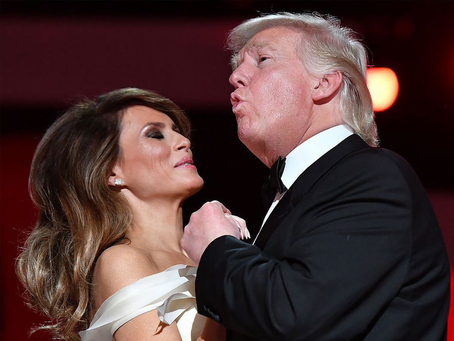 "WASHINGTON, DC - JANUARY 20: President Donald Trump singing along to ""My Way"" dances with first lady Melania Trump while attending the Freedom Inaugural Ball at the Walter E. Washington Convention Center on January 20, 2017 in Washington, D.C.  Trump will attend three inaugural balls.   (Photo by Kevin Dietsch - Pool/Getty Images)"