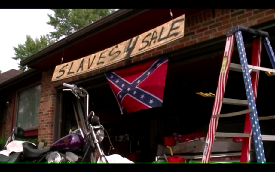 Man puts 'Slaves 4 Sale' sign over Confederate flag to make a statement that he's not racist