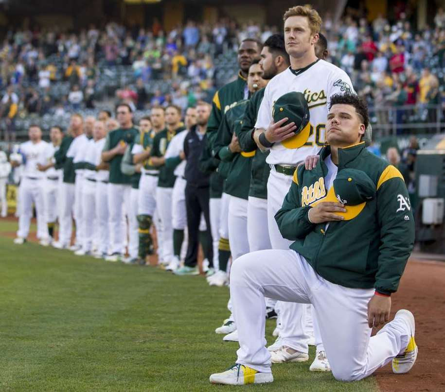A's rookie Bruce Maxwell becoming the first MLB player to take a knee for the anthem