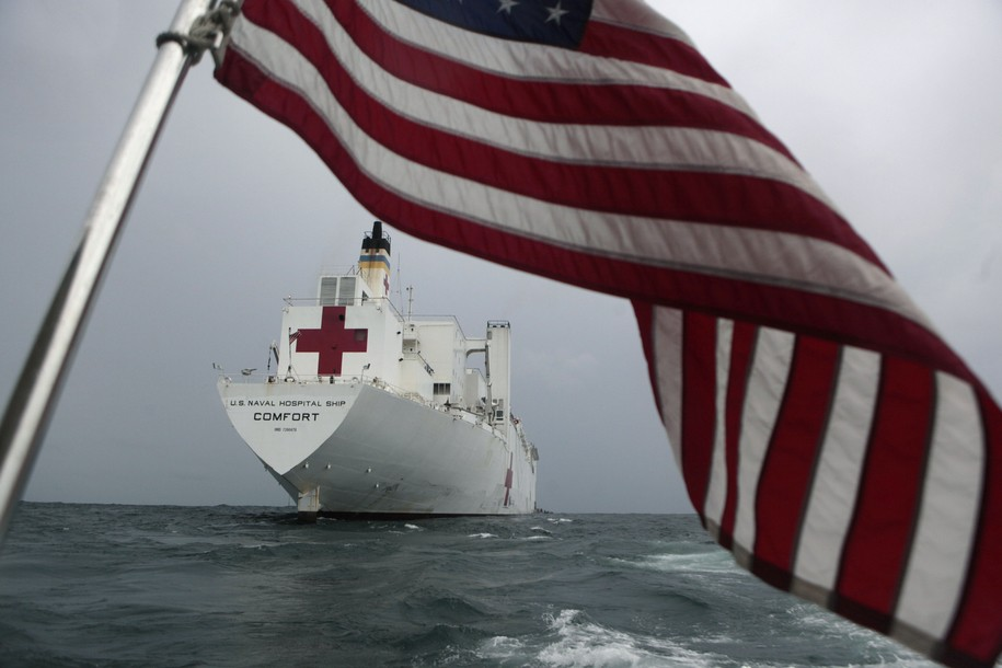 The U.S. Naval Hospital Ship Comfort is seen anchored at the San Juan del Sur Port, Nicaragua, Friday, June 24, 2011. The ship will remain in Nicaragua for 10 days to provide humanitarian assistance to residents who lives at the port area. In foreground, a U.S. flag. (AP Photo/Esteban Felix)