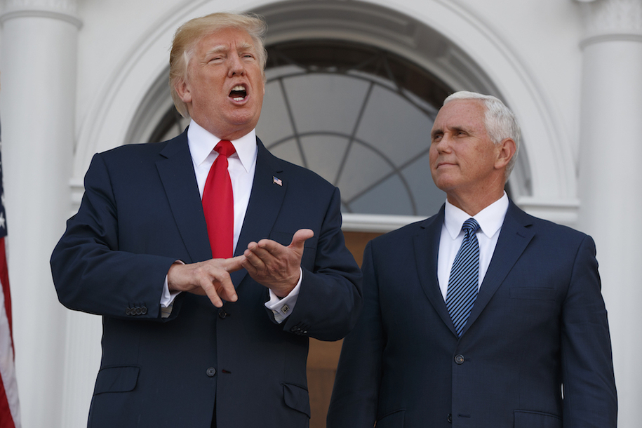 Vice President Mike Pence listens as President Donald Trump speaks to reporters at Trump National Golf Club, Thursday, Aug. 10, 2017, in Bedminster, N.J. (AP Photo/Evan Vucci)  ...