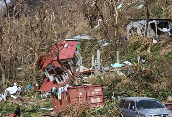 Homes lay scattered after the passing of Hurricane Maria in Roseau, the capital of the island of Dominica, Saturday, Sept. 23, 2017. Lives have been lost around the Caribbean, including on hard-hit Dominica. (AP Photo/Carlisle Jno Baptiste)