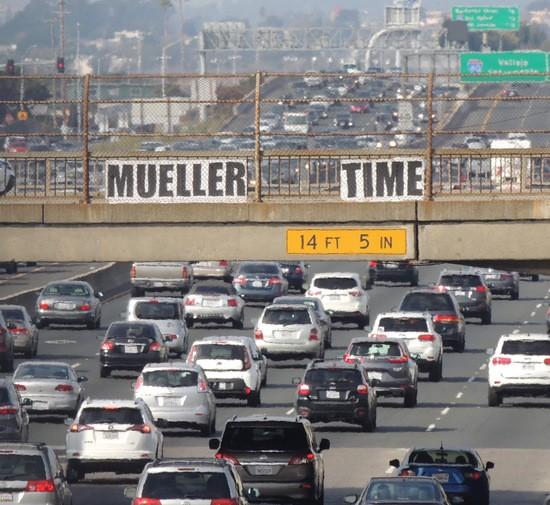 Mueller Time sign over I-80 Eastbound.