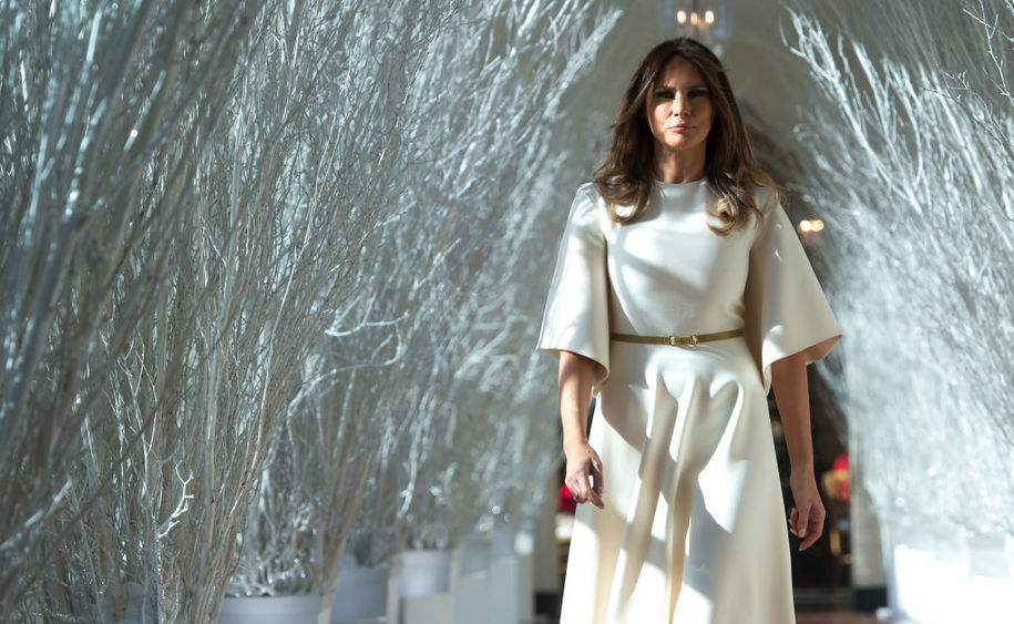 US First Lady Melania Trump walks through Christmas decorations in the East Wing as she tours holiday decorations at the White House in Washington, DC, on November 27, 2017. / AFP PHOTO / SAUL LOEB        (Photo credit should read SAUL LOEB/AFP/Getty Images)