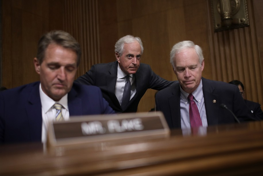 "WASHINGTON, DC - NOVEMBER 14:  Sen. Bob Corker (C) (R-TN), chairman of the Senate Foreign Relations Committee, confers with Sen. Ron Johnson (R) (R-WI) during a committee hearing November 14, 2017 in Washington, DC. The committee heard testimony on the ""Authority to Order the Use of Nuclear Weapons."" Also pictured is Sen. Jeff Flake (R) (R-AZ).  (Photo by Win McNamee/Getty Images)"