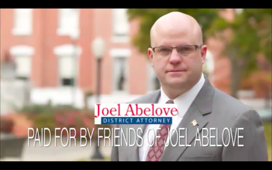 "Screenshot from ad for ""Joel Abelove for District Attorney."""