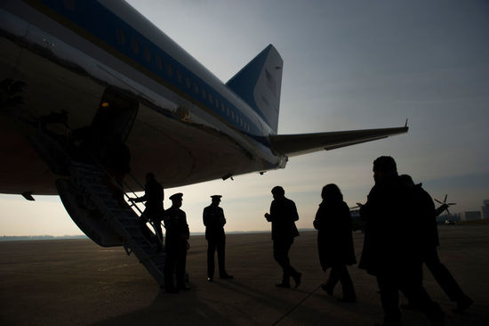 Journalists board Air Force One as US President Donald Trump departs from Andrews Air Force Base in Maryland, December 4, 2017, travelling to Salt Lake City, Utah. / AFP PHOTO / SAUL LOEB (Photo credit should read SAUL LOEB/AFP/Getty Images)