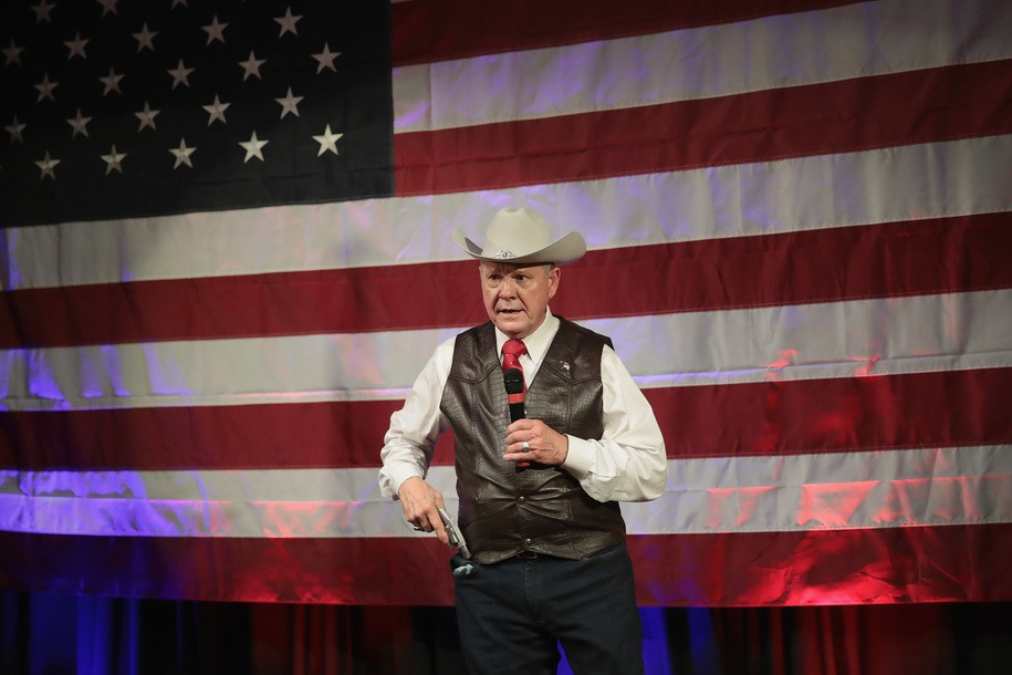 FAIRHOPE, AL - SEPTEMBER 25: Republican candidate for the U.S. Senate in Alabama, Roy Moore, displays a pistol to express his support for Second Amendment as he speaks at a campaign rally on September 25, 2017 in Fairhope, Alabama. Moore is running in a primary runoff election against incumbent Luther Strange for the seat vacated when Jeff Sessions was appointed U.S. Attorney General by President Donald Trump. The runoff election is scheduled for September 26. (Photo by Scott Olson/Getty Images)