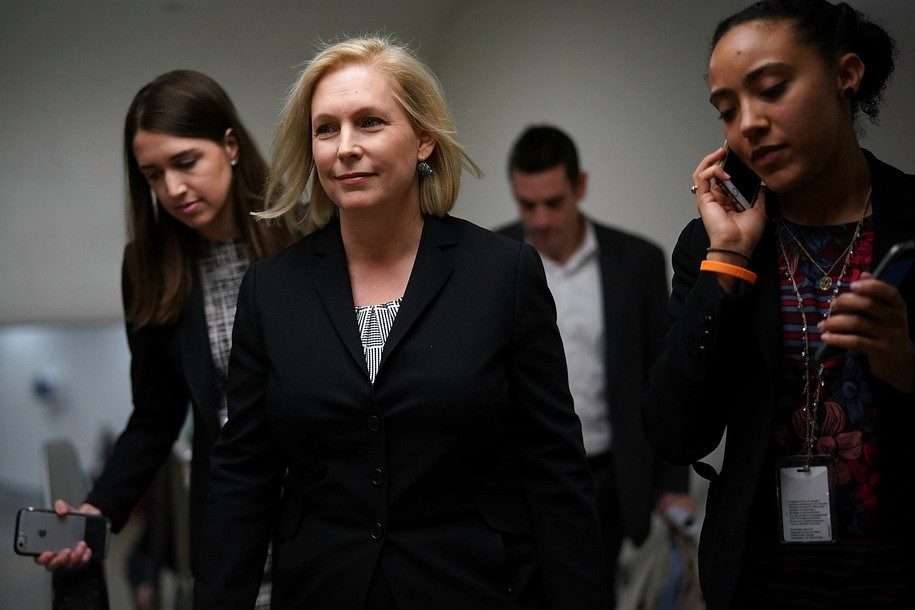 "WASHINGTON, DC - DECEMBER 12:  U.S. Sen. Kirsten Gillibrand (D-NY) (C) leaves after a news conference December 12, 2017 on Capitol Hill in Washington, DC. The lawmaker held a news conference to discuss ""the Stop Underrides Act of 2017,"" legislation designed to prevent deadly truck underride crashes, which occur when a car ""slides under the body of a large truck, such as a semi-trailer, during an accident.""  (Photo by Alex Wong/Getty Images)"