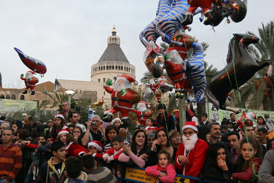 Israeli-Arab Christians attend a parade outside the Church of the Annunciation, built on the site where Christians believe Mary was told by the angel Gabriel that she would give birth to Jesus Christ, in the northern Arab Israeli city Nazareth on December 24, 2009. AFP PHOTO/JACK GUEZ (Photo credit should read JACK GUEZ/AFP/Getty Images)