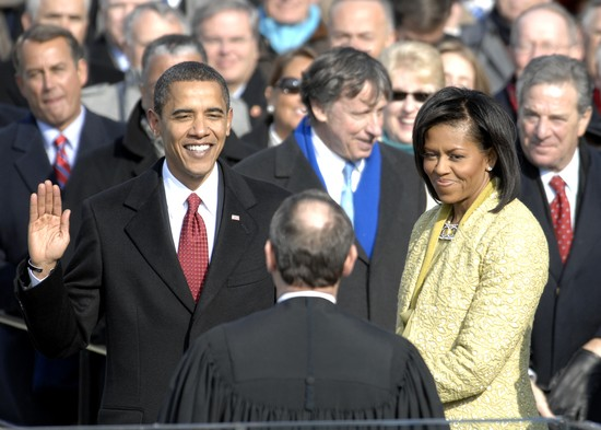 With his family by his side, Barack Obama is sworn in as the 44th president of the United States by Chief Justice of the United States John G. Roberts Jr. in Washington, D.C., Jan. 20, 2009.  More than 5,000 men and women in uniform are providing military ceremonial support to the presidential inauguration, a tradition dating back to George Washington's 1789 inauguration.  (DoD photo by Master Sgt. Cecilio Ricardo, U.S. Air Force/Released).