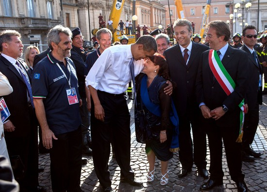 Touring earthquake damage during the G8 summit in L'Aquila, Italy, July 8, 2009.
