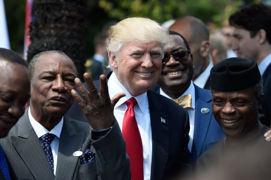 US President Donald Trump (C) shares a laugh with Guinea's President Alpha Conde (L), the Vice President of Nigeria Yemi Osinbajo (R) and other African leaders as they arrive to pose for a family photo with participants of the G7 summit during the Summit of the Heads of State and of Government of the G7, the group of most industrialized economies, plus the European Union, on May 27, 2017 in Taormina, Sicily..The leaders of Britain, Canada, France, Germany, Japan, the US and Italy will be joined by representatives of the European Union and the International Monetary Fund (IMF) as well as teams from Ethiopia, Kenya, Niger, Nigeria and Tunisia during the summit from May 26 to 27, 2017. / AFP PHOTO / POOL / STEPHANE DE SAKUTIN        (Photo credit should read STEPHANE DE SAKUTIN/AFP/Getty Images)
